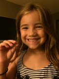 Lost her first tooth