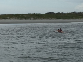 Eric & Cloe paddling to shore